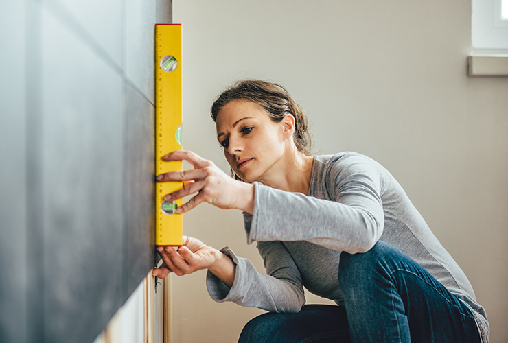 Woman measuring for gallery wall